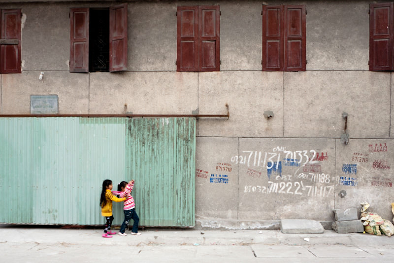 Two children playing on the way home from school. - Hanoi, Vietnam - Microsoft Unlimited Potential - Awareness and Annual Report