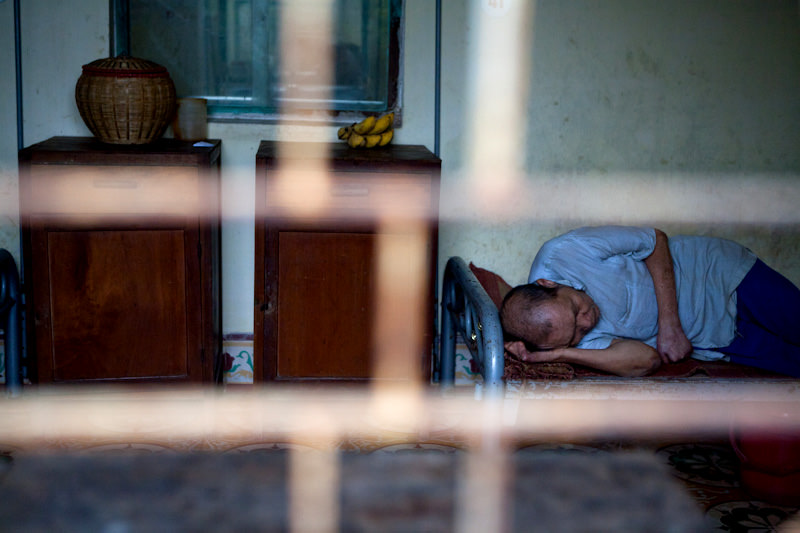 An elderly man takes a nap in the afternoon at the Van Mon hospital.  - Thai Binh, Vietnam - SEND ME - Donor Awareness