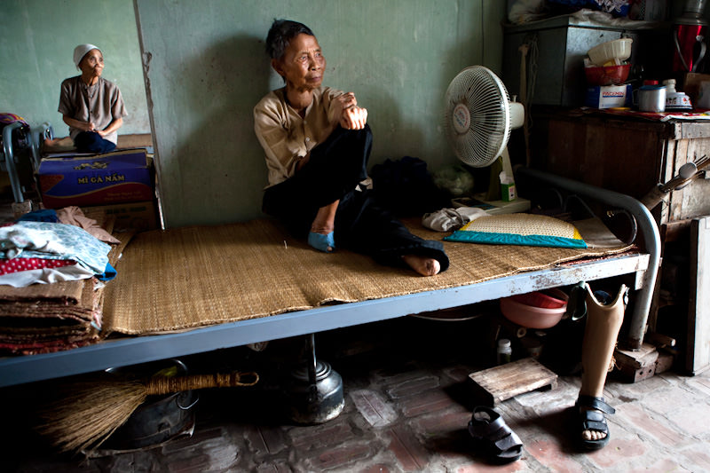 Two paitents sit inside as the summer mid day sun beats down outside.  - Thai Binh, Vietnam - SEND ME - Donor Awareness