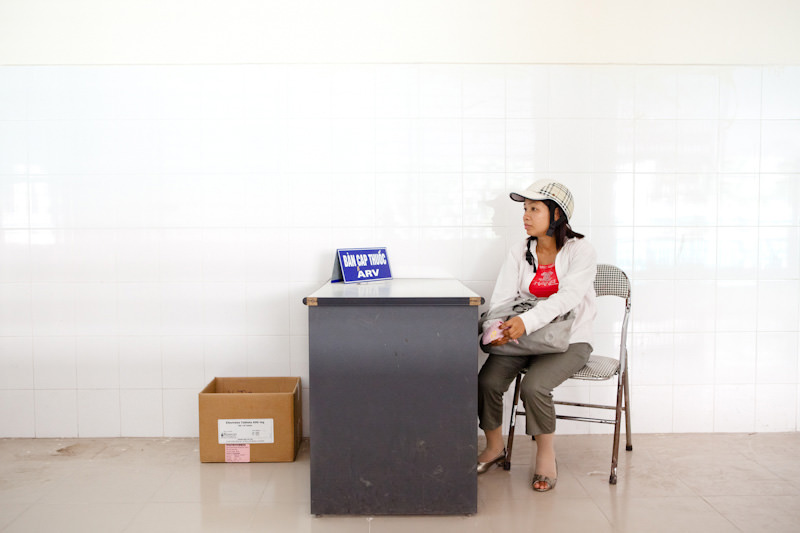 Mrs. Lan waits to pick up her ARV medicine. This medicine helps her lead a normal life and reduce the sideeffects HIV causes as it turns to AIDS.  - Hai Phong, Vietnam - Client: CESVI - Donor awareness