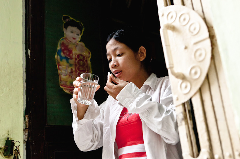 After Lan brings her daughter to school she takes her ARV medicine. Every morning and every evening Lan takes her medicine at exactly 8:00. The medicine has to be taken exactly at the same time everyday in order for it be be effective against HIV. - Hai Phong, Vietnam - Client: CESVI - Donor awareness